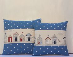 Seaside nautical cushions natural background with beach huts