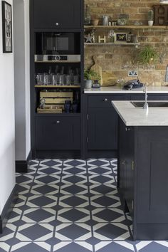 Harvey Maria's new Neisha Crosland Dovetail vinyl floor tiles are available in five distinctive tones of Flax, Ink Black, Lavastone, Ochre and Oxford Blue.