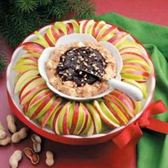 Festive Apple Dip Recipe:: coworker made this, it was excellent. Someone remarked that it tasted like peanut butter cups. I agree, tasty.