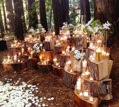 Beautiful outdoor ceremony set up with SO MANY CANDLES! I love the stumps that they used.