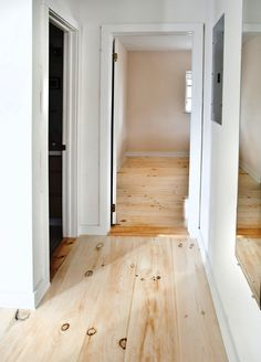To achieve this look, the homeowners first stained the floor white, then sanded off most of the stain before finishing with a clear water based interior poly from Old Masters.