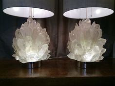 Natural rock crystal rocks assembled on Stainless steal base, with 3 led light inside. Each lamp has 39 kg and silk shade. Made by Demian Quincke in Brazil.