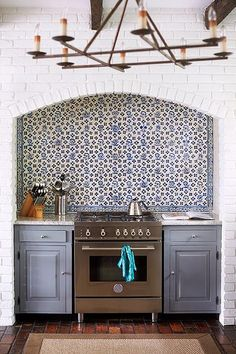 White brick and blue patterned tile kitchen