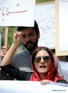 Afghans attend a demonstration condemning the violence against women in the country, in Kabul on July 31, 2012. Dozens of women and men staged a peaceful demonstration in Kabul on Tuesday, calling on government to stop violation against women in Afghanistan.