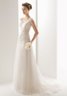 I like the gauzy texture and woven look of the bodice.