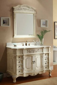 """42"""" Traditional Style Morton Bathroom sink vanity Model BA-2815W-AW-42 by Chans Furniture. $695.00. 8 functional sm. Drawers  2 front doors with large storage compartment. Optional Mirror available: $155.00 -   Size:32x40""""H  Optional Back splash: $75.00. White marble counter top - one piece genuine. White under mount porcelain basin. Faucets sold separately for $125 - 8"""" spread 3 holes. The antique white Morton bathroom vanity has classic traditional style. With carved decorati..."""