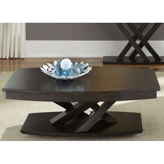 Add a twist to your living room furniture with a modern, criss-cross coffee table in a charcoal finish. (Matching End Table also available.) South Park Cocktail Table | Weekends Only Furniture and Mattress