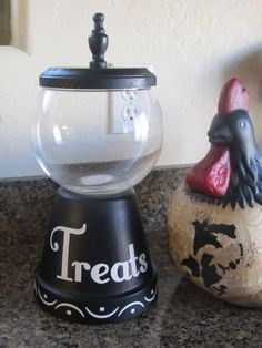 "Mom made this ""candy jar"". Terra cotta pot for the base, a glass bowl, small wood plaque and a finial for the top."