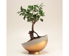 Gold colored handmade concrete sphere can be used in different angles on its metal ring base.  Sphere Gold can be used as a decorative object or it can