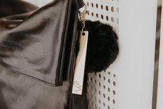 This polished leather, cross body bag is both versatile and functional. It features the classic MC combination hardware and leather removable strap. It has a sleek structured style when folded or leave it open for a casual look. FEATURES Internal zip pocket Two internal patch pockets Key clip Limited edition key ring a Casual Looks, Cross Body, Crossbody Bag, Hardware, Key, Pockets, Ring, Classic, Leather
