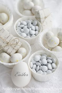 All white candies, eggs and packages make charming contents for baskets. Monogram eggs with rub on letters. www.HolidaywithMatthewMead.com