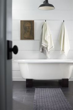 great bathtub for master bath. i like this whole aethetic. The hanging lamp might be a little trendy and date itself, but i like it right now. Would want something more classic, i think. Not tied to shiplap in the master bath, though. Not opposed either, but dont want to go shiplap crazy.