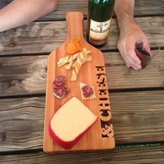 """Our & Cheese Board is a fun and witty way to serve the best. Each letter is hand-cut from butcher blockmade of hard maple. A truly unique cutting board that is sure to be noticed. This Cutting Board deserves a 2nd look! The wood color may vary slightly fromthe picture. 19"""" x 71/2"""""""" x 1 1/8""""  Made with butcher block, using sustainably harvested hard maple wood. Our products can be personalized with other words or names for a unique gift. CLICK HERE to person..."""