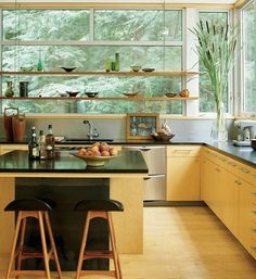 Open wooden wall shelves are great additions to modern kitchen design. They provide valuable and convenient storage spaces where you can not add cabinets. Open glass or wooden shelves are attractive stationary window decorating ideas that allow natural light to come into your kitchen and create func