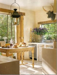 French country kitchen ... Love the table, not the partial animal carcass on the wall.