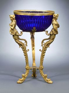 This rare center bowl is comprised of deep blue cobalt glass mounted in a magnificent ormolu stand. Circa 1880
