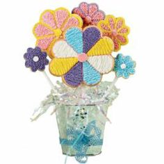 Everyone loves colorfully-decorated cookie pops, especially when they're popping out of a flowerpot. This easy-to-make gift is a great way to brighten someone's day.