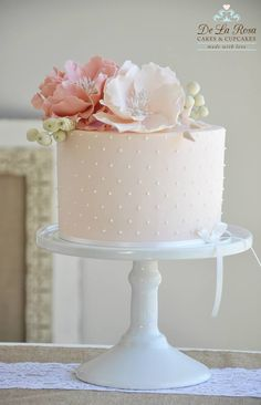 Soft pink colors with soft flowers on top. Like polka dots on side. Mat - not shiney