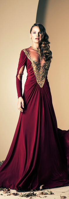 This beautiful gown is not identical to the gown of the Renaissance period yet it has a soft touch from the era. The velvet fabric and gold embroidery is something that the higher class would wear such as royalty.