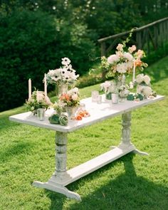 "A beautiful table at the outdoor ""altar"" came into play. A distressed farm table was rented and topped with mercury glass, candles, ornamental peaches, and flowers -- some of which were displayed in two of the couple's own vases"