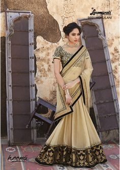 Appealing Black Cream Combined Net cum Georgette Lehenga Saree with amazing Diamond work on the fall amended with heavy jari work on the bottom carrying Rawsilk velvety resham jari worked blouse.