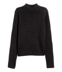 Black. Long-sleeved mock turtleneck sweater in a soft rib knit. Slightly wider cut.