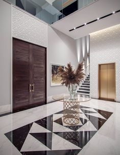 Family Villa Contemporary Arabic Interior Design – Riyadh, Saudi Arabia Family villa Contemporary Arabic Interior Design 7 – Elegant entrance lobby in the family villa contemporary Arabic interior design, with light gray walls adorned with white geometric Interior Design Examples, Interior Design Minimalist, Contemporary Interior Design, Decor Interior Design, Interior Decorating, Design Ideas, Modern Contemporary, Design Trends, Contemporary Furniture
