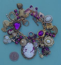 SWEET ROMANCE vintage & new junk jewelry charm bracelet with purple theme.