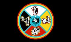 The Sault Ste. Marie Chippewa flag has a black background, which is unusual for any flag. It bears a colorful seal replete with symbolism. The seal is divided into quarters, each of a different color, representing a compass direction and bearing an animal symbolizing a particular clan. A teal-blue body of a turtle, completely circular and edged in aquamarine, forms the center of the seal. The Tribe describes its flag's symbolism (Wabun-Anong, pamphlet, June 1982)