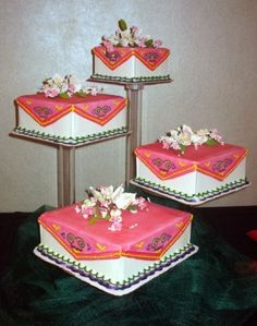 square Hmong - Inspired wedding cake By cakez on CakeCentral.com. I really like this idea because it allows you to have different flavors, Not crazy about the colors on this one however.