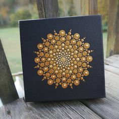 Gorgeous Golden Dot Mandala 6 x 6 original acrylic painting on wrapped box canvas. Painting is sealed and ready to hang. Canvas thickness is ~1.5 Please be aware that colors reflected on your screen may vary slightly from exact color in person. I use un-altered natural lighting in all my pictures. ***Each canvas piece comes with a signed and dated Certificate of Authenticity*** Piece will ship Insured via USPS Priority Mail (2-3 days.) ***Thank you for looking and have a beautiful day*** ...