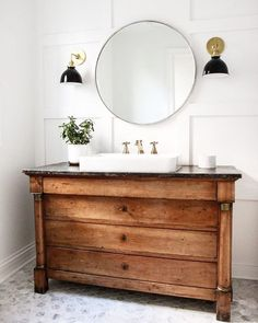 Lately I've been dreaming about a far off & away bathroom remodel (that unfortch probably won't happen yet this year). Do you think that stops a girl from dreaming though? Heck no! Check out the antique French Empire chest turned vanity, white paneling and black enamel sconces in @parkandoakdesign 's powder bath design. This space is killin' me right now in all its warm, vintage French glory! : @parkandoakdesign