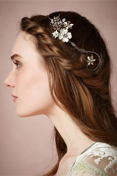 Love the halo look.  Its even a little different on both sides so it has a unique look.  Filigree Halo from BHLDN