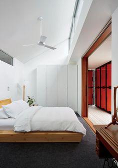 IKEA wardrobe and Rye Dunsmuir bed in Tasmanian prefab by Misho+Associates.