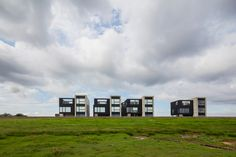 'Black Sun' is cluster of dwellings designed by Arkitema Architects on the Danish island of Rømø.