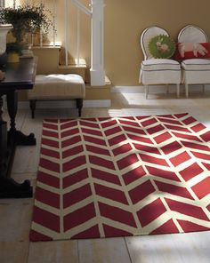 our chevron rug in berry red