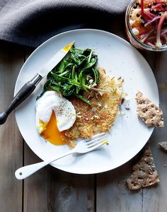 Poached eggs over rosti with sauteed ramp greens and pickled ramps.