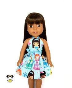 Magical and fun in this princess doll dress, perfect for the Wellie Wishers! The dress features a brown hair princess print on a blue background with a blue ribbon tie. Item was handcrafted in our pet free, smoke free sewing studio. • Listing includes – 1 Halter dress ( brown hair /