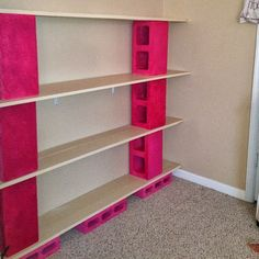 WHITE PAINTED inexpensive shelving -- HEAVY!   Now the fun begins, adding books to these diy shelves. Painted pink as you can never have enough of this color! Word to the wise, when paint...