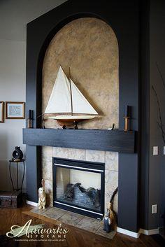 Decorative Stone Fireplace glazed finish over white stone with decorative concrete hearth
