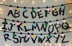 Get your hands on our super cool backdrop, inspired by the Netflix show Stranger Things! Featuring the full 26 letters of the alphabet, the font carefully designed by us to resemble the paint Winona daubed on the walls, each with a coloured string light bulb above each letter. Hand made