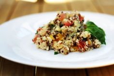 Chopped vegetable and fresh basil quinoa salad - a good light base salad to adapt and add whatever you have on hand to - like the light dressing