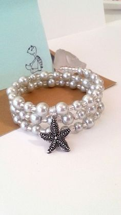 Grey pearl memory wire bracelet with starfish by beachseacrafts