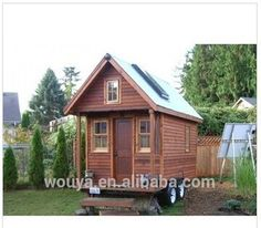 Log cabin motor wood house for car traveling with steel base and wheel