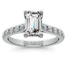 Regal elegance: The Trellis Diamond Ring in stylish White Gold. The prong-set round diamonds add a definitive shimmer to this setting, bringing out the beauty of the Emerald-cut center stone! http://www.brilliance.com/engagement-rings/trellis-diamond-ring-white-gold