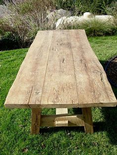 This table was custom built for a customer using planks a very unique batch of threshing floor. The base was constructed using barn oak planks and beams. Products Used: As Is Threshing Plank, As Is Brown Barn Oak Plank, Sanded Barn Oak Plank