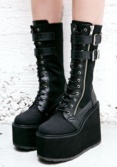 Demonia Wyvern Rider Platform Boots cuz yer gonna cut right through 'em with a little help from your winged friends, babe! These dangerous 'n suuuper high treaded platform boots feature a sturdy black canvas construction with 100% vegan leather detailing along the laces and heel, rounded toe, two adjustable buckle straps across the top, and a full length side zip closure.