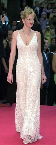 Cannes retrospective: Melanie Griffith: Out on the red carpet with hot hubbie Antonio Banderas, Melanie Griffith shone in a floor-skimming white gown with plunging neckline and lace detail. White Gowns, White Dress, Nice Dresses, Prom Dresses, Conservative Fashion, Melanie Griffith, Female Stars, Festival Dress, Red Carpet Dresses