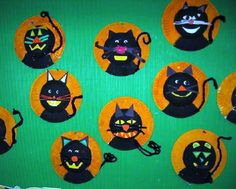 black cats on painted paper plates