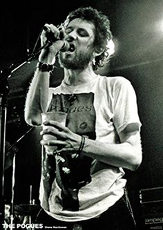 THE POGUES SHANE MACGOWAN POSTER - Get ready to walk on the sunny side of the street! This poster will make a great gift for any Pogues fan and features a black and white photograph of lead man Shane Macgowan singing at a live performance.